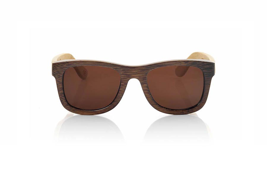 Wood eyewear of Bamboo WOODHEART S. The sunglasses Woodheart are made of bamboo wood, with the front dyed  in brown tones and sideburns in natural bamboo color  where the wood grain is always present Its a classic frame with a small size for people who feel better glasses Small. Front measssure: 136x44mm  |  Root Sunglasses®
