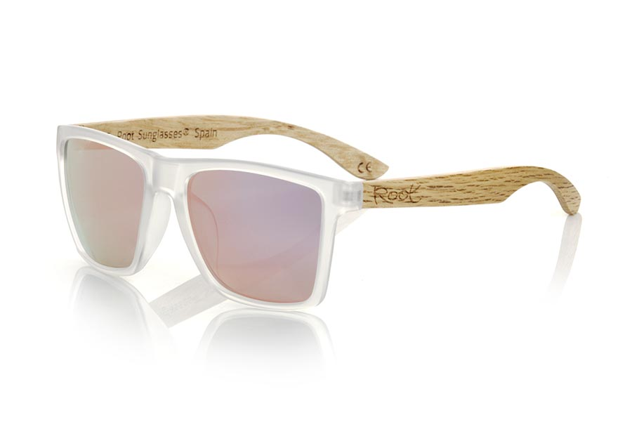 Wood eyewear of zebra modelo RUN TR DS. The RUN TR DS sunglasses are made with the front of transparent matte synthetic material and the temples in zebrano, it is a very masculine angular square model with an air to the famous okley combined with four lens colors that are They will adapt perfectly to your taste and your modern style. Front Measurement: 144X51mm | Root Sunglasses®