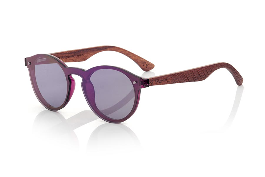 Wood eyewear of Rosewood modelo SUN PINK. PINK SUN sunglasses are made with the PINK plastic front and sideburns in rosewood engraved with an ethnic pattern, it's a female model rounded very current trend <b>PC not POLARIZED</b> lenses cover around the front. Front size: 136X49mm | Root Sunglasses®