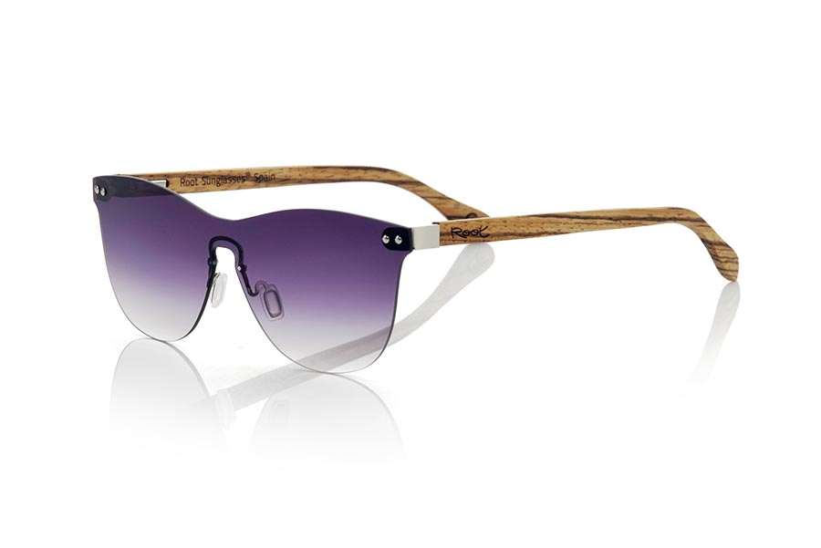 Wood eyewear of Zebra modelo SUNSET ZEB. The SUNSET ZEB sunglasses are made without frame and it is the flat lens that makes the functions of the saddle, the sideburns are made of ZEBRANO wood, it is a model of last trend, the flat lenses <b> non-polarized PC </b> cover the whole frontal. Frontal measurement: 139X49mm | Root Sunglasses®