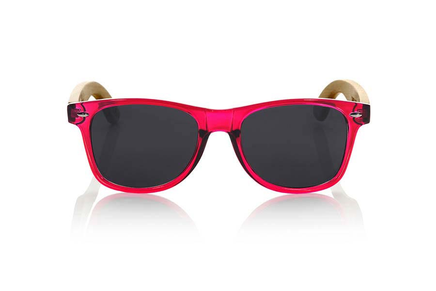 Wood eyewear of Bamboo CANDY PINK. Candy Green sunglasses are made with synthetic dark red transparent front and sideburns in natural bamboo combined with four lens colors that will adapt perfectly to your taste and your modern style. Front Measure: 148x50mm  |  Root Sunglasses®