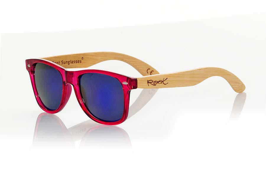 Wood eyewear of Bamboo modelo CANDY PINK. Candy Green sunglasses are made with synthetic dark red transparent front and sideburns in natural bamboo combined with four lens colors that will adapt perfectly to your taste and your modern style. Front Measure: 148x50mm | Root Sunglasses®