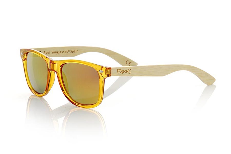 Wood eyewear of  modelo CANDY YELLOW. Candy Yellow sunglasses are made with synthetic dark Yellow transparent front and sideburns in natural bamboo combined with four lens colors that will adapt perfectly to your taste and your modern style. Front Measure: 148x50mm | Root Sunglasses®