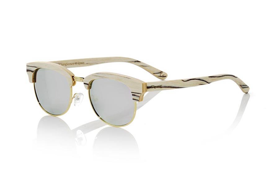 Wood eyewear of White Wood modelo HAYMAN. HAYMAN sunglasses are made of white Wood. It is an open unisex model with the lower ring and Golden bridge and adjustable nose pads. Standard size Hayman adapt to all types of faces and people. We have combined them with various types of PC lenses. Frontal measurement: 138x46mm | Root Sunglasses®