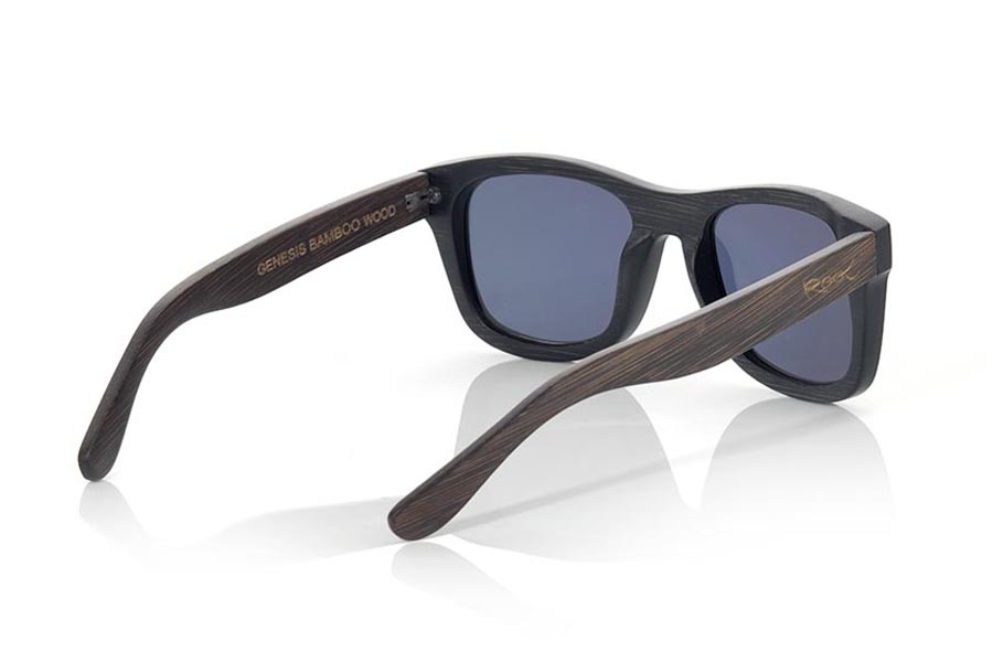 Wood eyewear of  GENESIS. Genesis Wood Sunglasses are made in two-tone tinted bamboo with black front and dark brown sideburns. In classical forms, the Genesis is a unisex model, elegant and discreet, however they will not be able to stop looking at you. frontal measurement:  146x50mm  |  Root Sunglasses®